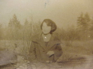 Mom in Coat-Bobbed Hair-at her old Family Home I think